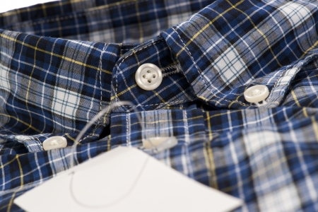 Closeup of blue color shirt for men in checked pattern photo