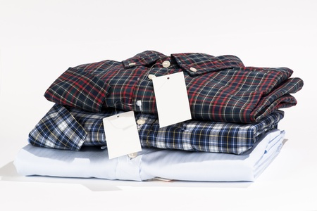 Stack of folded shirts with blank label