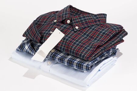 Stack of folded shirts with blank label photo