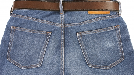 Blue Jeans with brown leather belt on white background photo