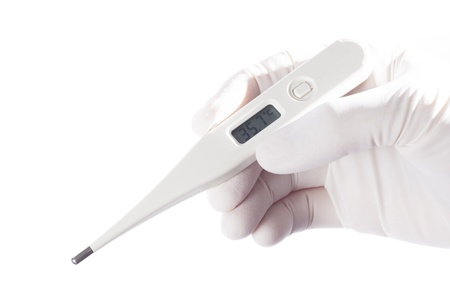 Hand with medical gloves and thermometer on white background photo
