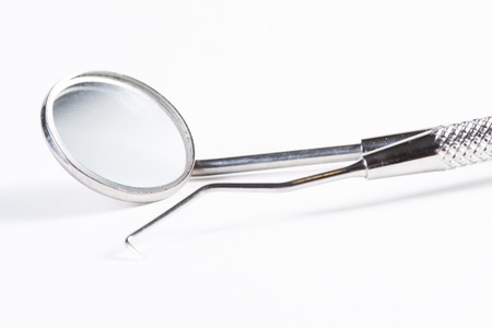 Two Dental Tools : Dental mirror and probe on white background