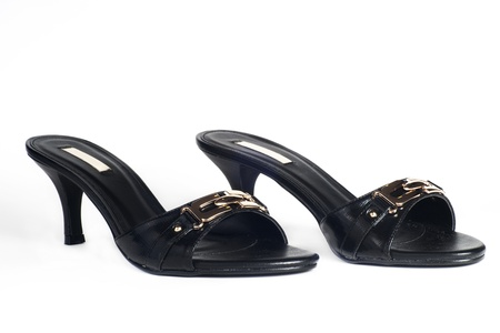 Pair of black high heel female shoes on white background photo