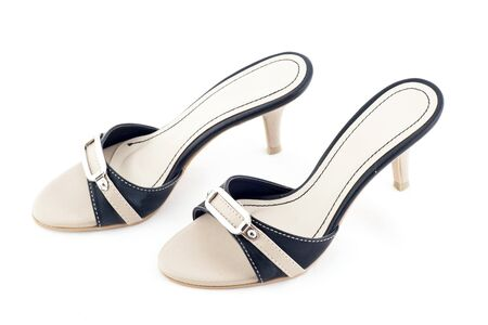 Pair of beige female shoes on white background photo