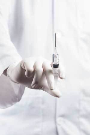 Doctor  Nurse holding a syringe ready an injection