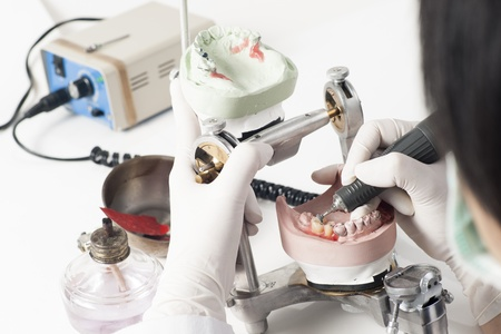 prosthetics: Dental technician working with articulator in dental laboratory  Stock Photo