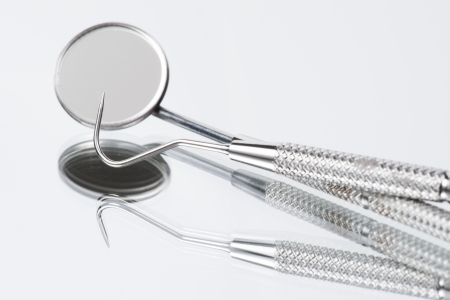 Set of dental tools on mirroe background photo