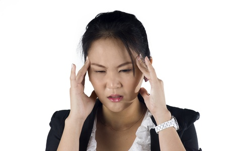 Stressed business woman with a headache isolate on white background, Model is a Asian woman. photo