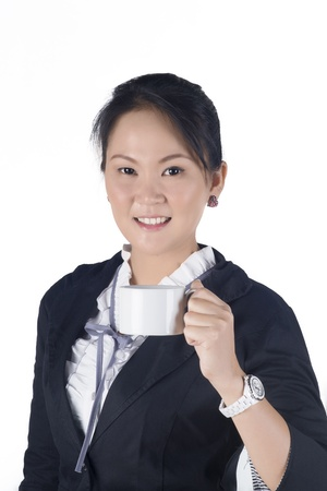 Portrait of attractive young business woman hold a cup of coffee isolated  white background, Model is Asian woman.  photo