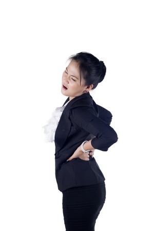 Business woman with back pain isolated white background, Model is Asian woman. Stock Photo - 16491751
