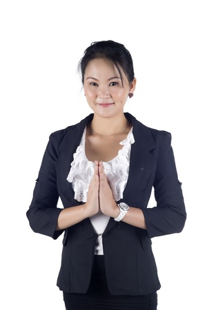 Thai business women in a traditional welcoming gesture, isolated on white background  Stock Photo