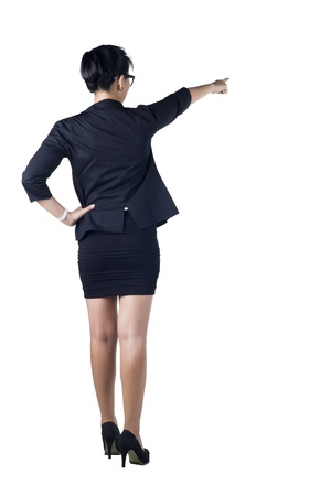 Rear   Back view of business woman standing and pointing  Isolated white background  Model is Asian woman