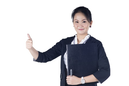 Successful business woman showing thumbs up sign, holding black file, isolated white background   photo