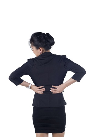 Business woman with back pain isolated white background, Model is Asian woman. Stock Photo - 16927836