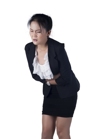 Business woman suffers from stomachache, isolated on white background, Model is Asian woman.