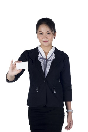 Business woman in black suit handing a blank business card, Isolated on white background. Model is Asian woman. Focus at the card photo