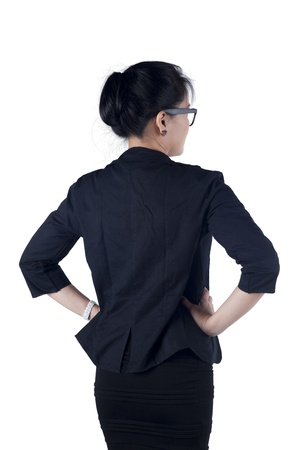 Rear  Back view of business woman standing. Isolated white background. Model is Asian woman. photo