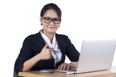 Portrait of confident business woman sitting at the table and working on the laptop, Isolated on white background. Model is Asian woman. Banco de Imagens - 17767300