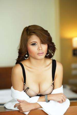 Young beautiful Asian woman in sexy lingerie. photo