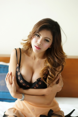 Young beautiful Asian woman in sexy lingerie. Stock Photo