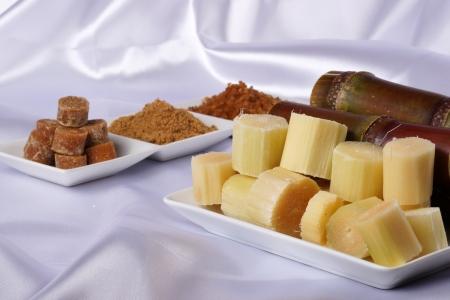 Various kinds of sugar, brown sugar, reed sugar, sugar cane and cane. photo