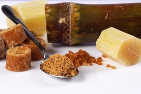 Various kinds of sugar, brown sugar, reed sugar, sugar cane and cane. Stock Photo - 18518578