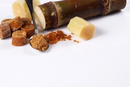 Various kinds of sugar, brown sugar, reed sugar, sugar cane and cane. Stock Photo - 18518517
