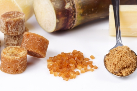 Various kinds of sugar, brown sugar, reed sugar, sugar cane and cane. photo