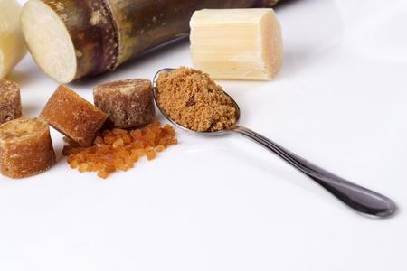 Various kinds of sugar, brown sugar, reed sugar, sugar cane and cane. Stock Photo - 18518512