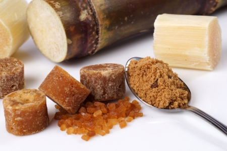 Various kinds of sugar, brown sugar, reed sugar, sugar cane and cane. Stock Photo - 18518585