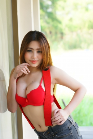 Young beautiful Asian woman in red lingerie voluptuous posing outdoors  photo