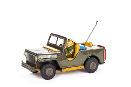 Vintage military toy car on white background.