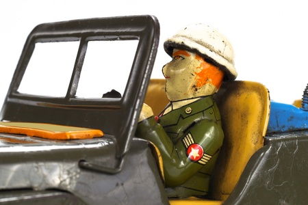 Vintage military toy car on white background. photo