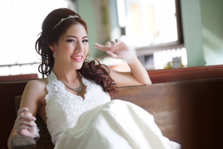 Young Asian lady in white bride dress Banco de Imagens