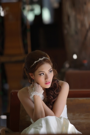 Young Asian lady in white bride dress, Model is Thai Ethnicity photo