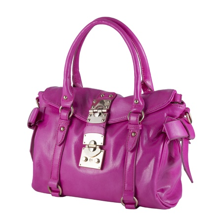 Womans handbag Pink color, isolated over white photo