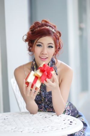 Beautiful young woman opening gift box,Thai Ethnicity Stock Photo