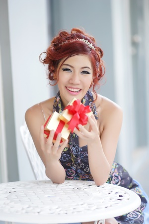 Beautiful young woman opening gift box,Thai Ethnicity photo
