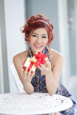 thai ethnicity: Beautiful young woman opening gift box,Thai Ethnicity Stock Photo