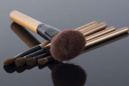 Set of make-up brushes on black background  photo