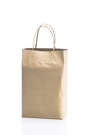 Blank brown paper bag on white background  photo