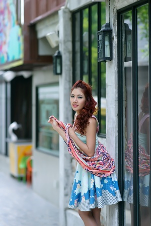 Beautiful young woman stand alone at the outdoor mall, Model is Thai Ethnicity  photo