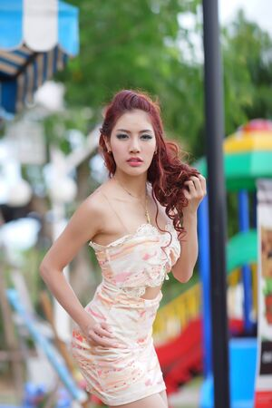 thai ethnicity: Beautiful young woman stand alone at the outdoor mall, Model is Thai Ethnicity.