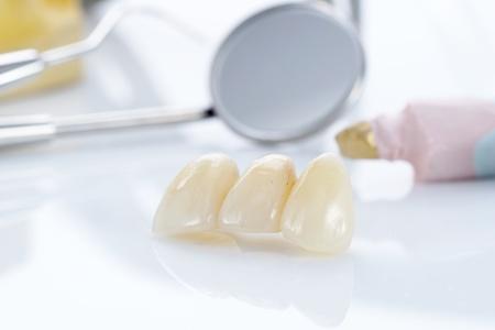 Macro of prosthetic teeth with dental tools Stok Fotoğraf