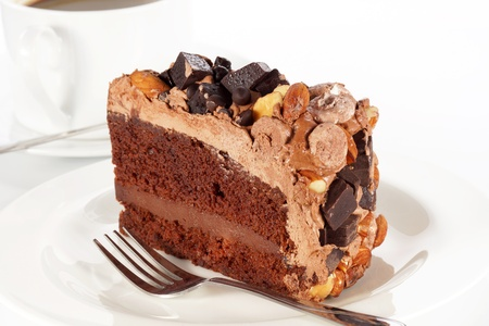 Sweet chocolate cake topping with chocolate and almond nut. photo