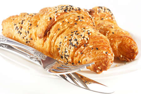 Delicious croissant on white plate and white background