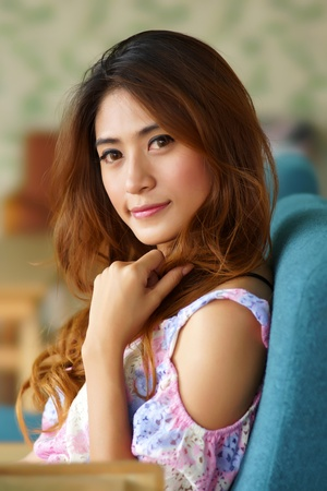 Beautiful young woman posing alone in the cafe, Model is Thai Ethnicity.