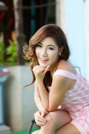 Beautiful young woman posing alone at the outdoor cafe, Model is Thai Ethnicity.