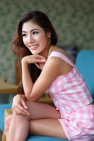 thai ethnicity: Beautiful young woman posing alone in the cafe, Model is Thai Ethnicity.