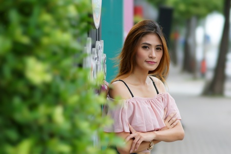thai ethnicity: Beautiful young woman posing alone at the outdoor cafe, Model is Thai Ethnicity.